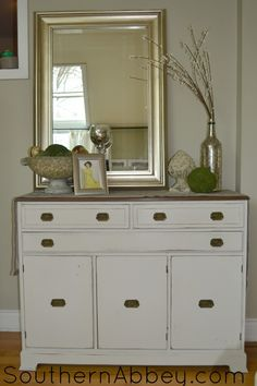 Mahogany Sideboard painted white and distresed. southernabbey.com #sideboard #buffet