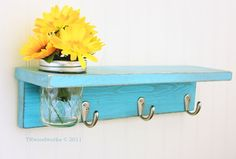 Like this for bathroom...hang towels on hooks - use jars for cotton balls, q-tips, etc.  Could even paint cute word/words on the hook portion.