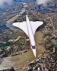 Concorde flying over London! Watched these several times sitting in Kew Gardens.