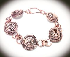 Antiqued copper linked coil wrapped bracelet by JCLwire on Etsy Copper Wire Jewelry, Wire Jewelry Designs, Copper Bracelet, Resin Jewelry, Antique Jewelry, Bangle Bracelets, Silver Jewelry, Jewelry Shop, Jewelry Ideas