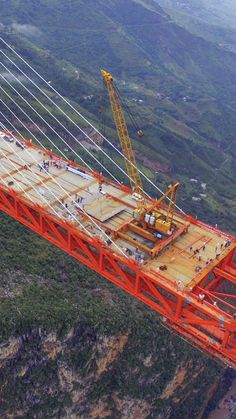 The highest bridge in the world is almost open...The Beipanjiang Bridge suspends nearly 2,000 feet above the Beipan river, and extends 2,300 feet between China's mountains. When the construction is completed, the extension will cut the travel time between Yunnan and Guizhou, two provinces, in half.