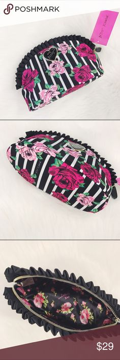 🎉FINAL SALE🎉Betsey Johnson Cosmetics Bag Brand new with tags, large floral cosmetics bag ,will privide the measuremets upon request, floral stripe print, one main zipper. Ruffle around the zipper.                     ✅🎉FINAL SALE🎉✅         🎄10% off bundle of 2 items or more!🎄                             •NO TRADING                             •smoke free                             •fast shipper Betsey Johnson Bags Cosmetic Bags & Cases
