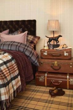 Old fashioned blankets on top of nice blanket  Suitcases as side table or side table to chair but this is really good bedroom