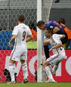 De Vrij of the Netherlands scores near Spain's Torres and Azpilicueta during their 2014 World Cup Group B soccer match at the Fonte Nova are...