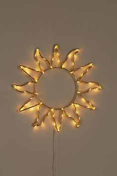 Shop Celestial Sun Light Sculpture at Urban Outfitters today. Yellow Room Decor, Cute Room Decor, Yellow Bedroom Decorations, Dorm Decorations, Sunflower Room, Sunflower Wall Decor, Decoration Bedroom, Aesthetic Room Decor, Sun Aesthetic