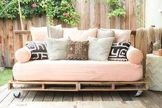 Pallets and metal pipes are an inexpensive, not too hard means, for anyone to make a sweet, comfortable sofa or bed for indoors or out.  Have fun with paint, nail on trim to cover out the front and sides, and it will look like a million bucks!  Dont forget cushions all sorts.