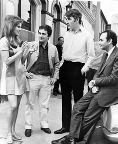 Raquel Welch, Dudley Moore, Peter Cook and director Stanley Donen during the filming of Bedazzled, 1967