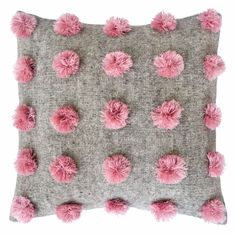 Handwoven gray pillow with pompoms