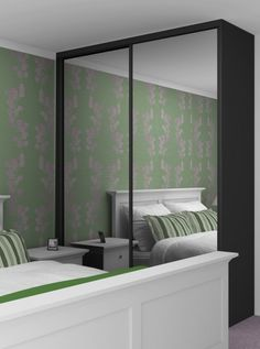 cupboard with fully-mirrored sliding doors and a surface that can be painted. initial colour to be white.