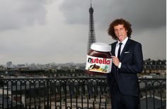 This is just nuts! Luiz holds a superimposed jar of Nutella in front of a Parisian skyline in another meme