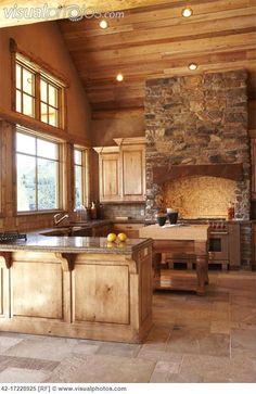 Kitchen with Stone Range Hood