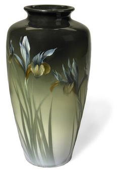 A Rookwood dark iris glazed earthenware Iris vase decorator Carl Schmidt, (1910
