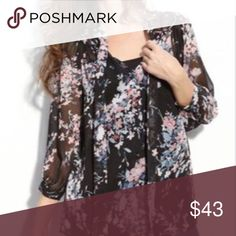 Bellatrix Black Floral Blouse Sheer black blouse with floral print. Buttons in the front with a tie. Looks great on. Can be worn anytime of year (in the fall/winter I would pair this with black boots and a leather jacket). bellatrix Tops Blouses