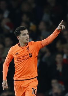 Liverpool's Brazilian midfielder Philippe Coutinho celebrates scoring the team's first goal during the English Premier League football match between Arsenal and Liverpool at the Emirates Stadium in London on