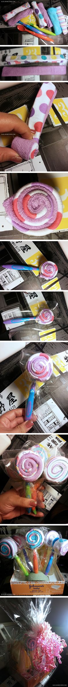 DIY: Baby shower gift wrapping idea. Making a lollypop out of washcloths and baby spoon. Very easy to do! :)