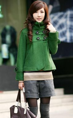 Love this jacket! It's a lovely shade of green with fun buttons and design. I also noticed how she has both socks and tights. I love that when it can be pulled off, especially when it's kinda chilly. If it's too cold I would rather wear pants though.