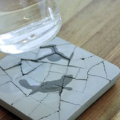 Water absorbent coasters made out of actual concrete, in dry land look. $12