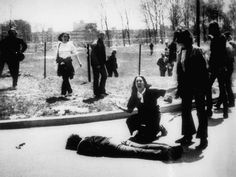 In this May 4, 1970 file photo, Mary Ann Vecchio gestures and screams as she kneels by the body of a... - AP Photo/John Filo