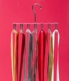 Turn a tangle of ribbons into a neat presentation. Hang coordinating colors over the prongs of a tie hanger.