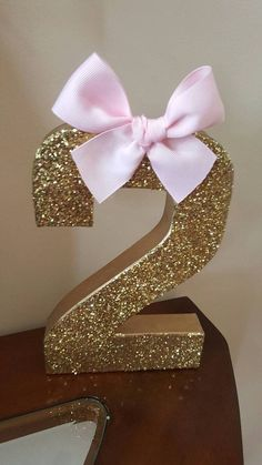Gold glitter and pink bow age # centerpiece, party decoration $12