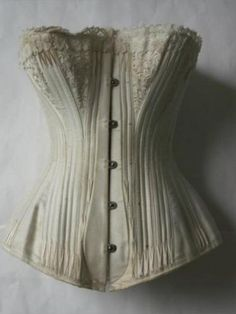 Bridal Corset 'The Celebrated C.B. Bridal Corset' Maker: l'toile C.B Date: 1890 FRANCE ? Silk, coutil, whalebone ?, lace, metal  Corset in silk satin with floss embroidery. Delicate flowers are embroidered over breast gussets. The corset has metal slot and stud fastening down the front of busk and is back lacing with metal eyelets. Silk floss embroidery features at top and bottom of boning channels on front of corset to prevent boning from penetrating the exterior silk.