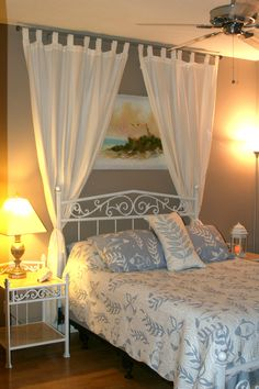 beach theme guest bedroom with diy wood headboard wall art and lots of annie sloan chalk paint - Beach Themed Bedrooms