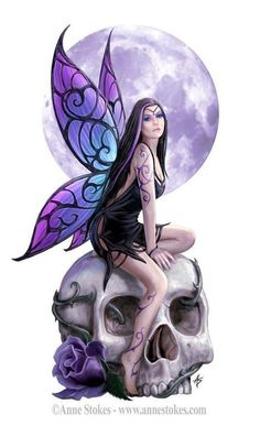 Gothic Fairy sitting on a giant skull
