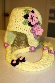 Rapunzel Flowered crochet hat, Natalie and Madisen would absolutely love this. Crochet Baby Hats, Crochet Beanie, Knit Or Crochet, Cute Crochet, Crochet For Kids, Crochet Crafts, Crochet Clothes, Crochet Toys, Crochet Projects