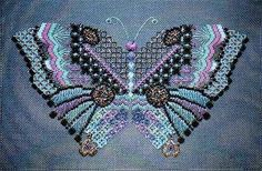 The jewel-toned version of Butterfly 5.  Charted needlepoint canvaswork pattern or kit available.