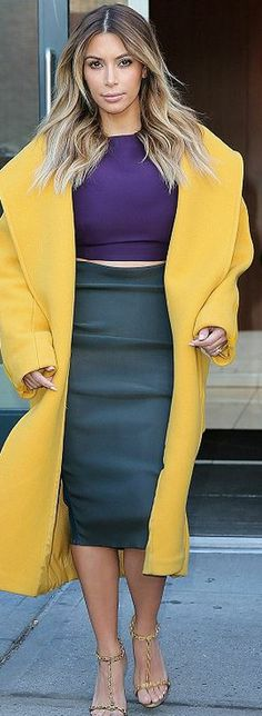 Who made  Kim Kardashian's green high waist skirt, yellow coat, and gold sandals that she wore in New York?