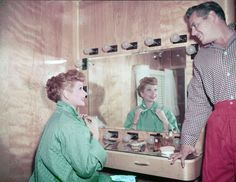 Lucille Ball and her husband Desi Arnaz get ready for their closeup, 1955.