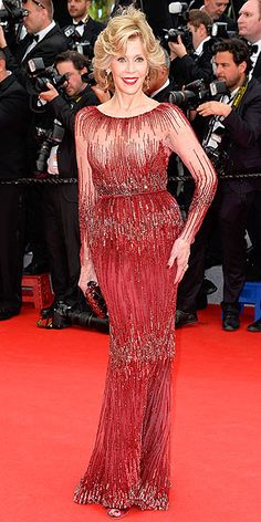 On the Red Carpet at Cannes | JANE FONDA | She matches the red carpet, but that doesn't mean Jane fades into the background at the opening ceremony. Not when she's in an allover-beaded Elie Saab creation with a cinched waist and sheer sleeves and décolletage.