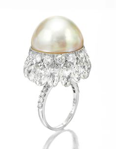 Viren Bhagat. A Natural Pearl, Platinum and Diamond Ring, by Viren Bhagat.  Available Exclusively at FD.  www.fd-inspired.com