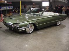 Chip Foose did this '65 T-Bird custom for an episode of Overhaulin'. My father had a very similar '64 convertible in a dark aqua. It was one of my favorite cars he ever had (and he seldom kept a car more than a year).