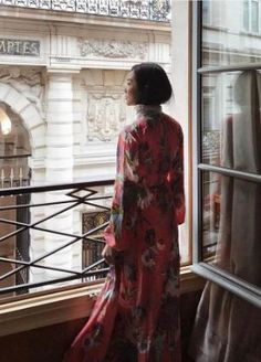 Yoyo Kulala wears the Crew Neck Floor Length Dress in Curzon pink floral print.