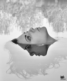 Looking through the Ice she sees the other side of herself. Wondering what she would be like or how she lives in the world below she looks in and asks her twin the Question.