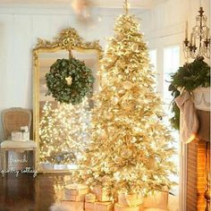 Don't want traditional Merry Christmas decorations? A pre lit white Christmas tree is just what you need. Try these white Christmas tree decorating ideas. Gold Christmas Tree, Christmas Time Is Here, Merry Little Christmas, Beautiful Christmas, Christmas Home, Christmas Holidays, Christmas Music, Christmas Mantles, Christmas Villages