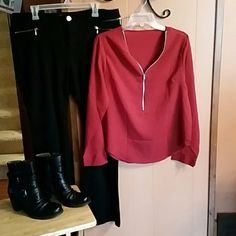 Red zip front blouse. New with tag.  Beautiful red color. This blouse is pretty sheer. You may want to wear a cami underneath.  25 inches from shoulder to hem. 21 inches armpit to armpit. Boutique  Tops Blouses