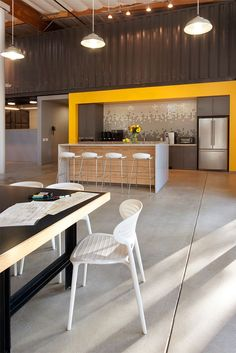 Love the wall tile, clean lines and pop of color- Office design office Cuningham Group