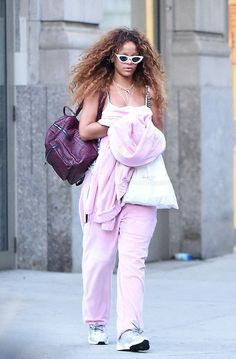 Rihanna On her way to the airport wearing le specs sunglasses and reflective puma sneakers