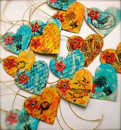 Made from Recycled Cardboard.  I'd add Scriptures to mine.  These are fantastic!  I love the vivid colors.  Hands and Heart: MIxed Media Book Marks, Embellishments, Tags and Art.