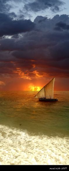 Sailing at sunset under stormy skies http://itz-my.com