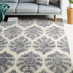 Hand tufted by skilled artisans in India, our Sarasa Wool Rug pairs modern durability with the distressed look of an antique. The large-scale medallion motif adds a dose of drama.