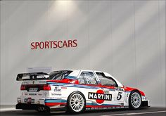 Alfa Romeo 155  -Martini Racing. Beginning to wonder if there is anything they have not sponsored. The Popemobile?