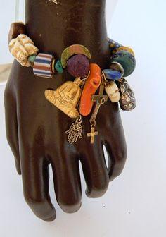 Amulet charm bracelet w/Christian Ganesh Buddha Hamsa by Dabanga. American Made. 2013 Buyers Market of American Craft. americanmadeshow.com