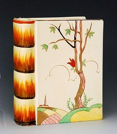 Clarice Cliff - Spire - A novelty flower vase circa 1936 in the form of an open book hand painted with a stylised tree landscape with church to the distance, large black script mark, height Clarice Cliff, Vintage Pottery, Pottery Art, Tumblr Backgrounds, Ceramic Artists, Flower Vases, Flowers, Art Pictures, Art Deco