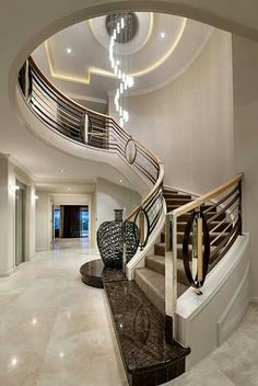 Luxury interiors luxury homes, curved staircase, grand staircase, stair rai Home Stairs Design, Railing Design, Interior Stairs, Dream Home Design, Home Interior Design, House Design, Foyer Design, Mansion Interior, Luxury Staircase