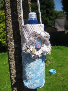 Like this idea for a water bottle holder.  Change from modern fabric and omit the flower