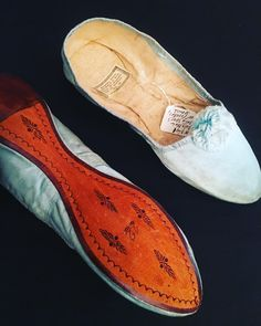 Putting your best foot forward...Charming little flats made around 1805-1810. -Cora Ginsburg Gallery, NY #19thcentury #shoes #balletstyle #blue #coraginsburg #vintageshoes #antiqueshoes