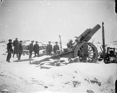 """MINISTRY INFORMATION FIRST WORLD WAR OFFICIAL COLLECTION (Q 4699)   An 8"""" howitzer about to be fired. In the snow, Pozieres, February 1917."""